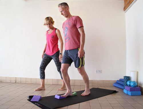 Photo of Vanessa helping a client with correct foot stance