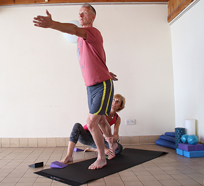 Photo of Vanessa helping a client with balance
